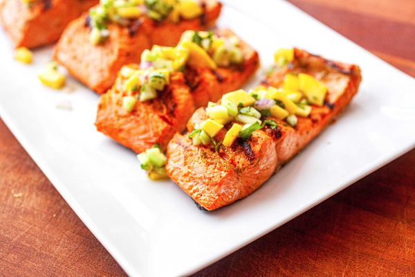Grilled Salmon Fillet with Mango Salsa - grilled salmon portions on a plate with fresh salsa