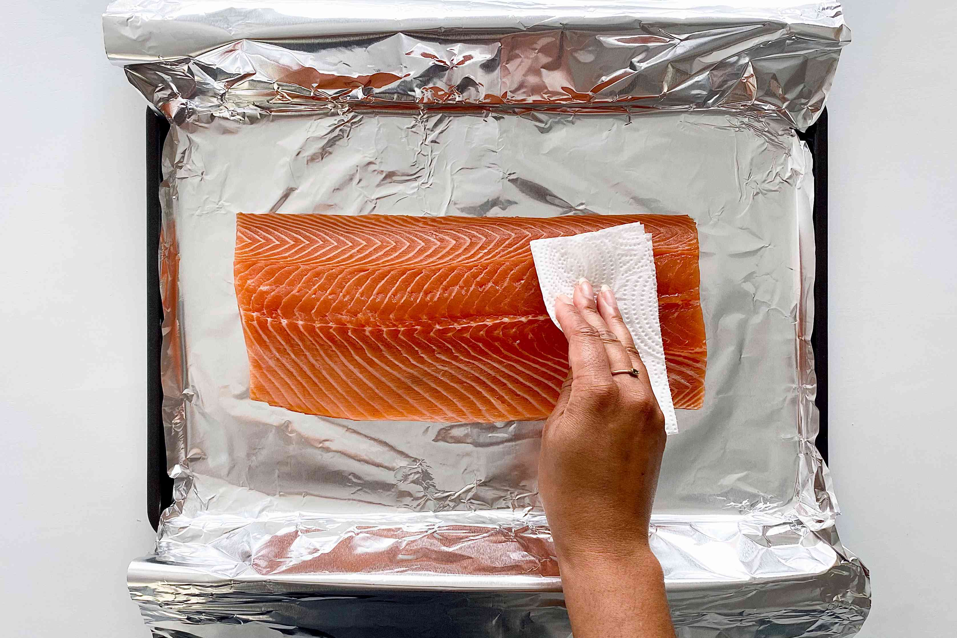Salmon on a foil lined baking sheet to make Garlic Butter Baked Salmon.