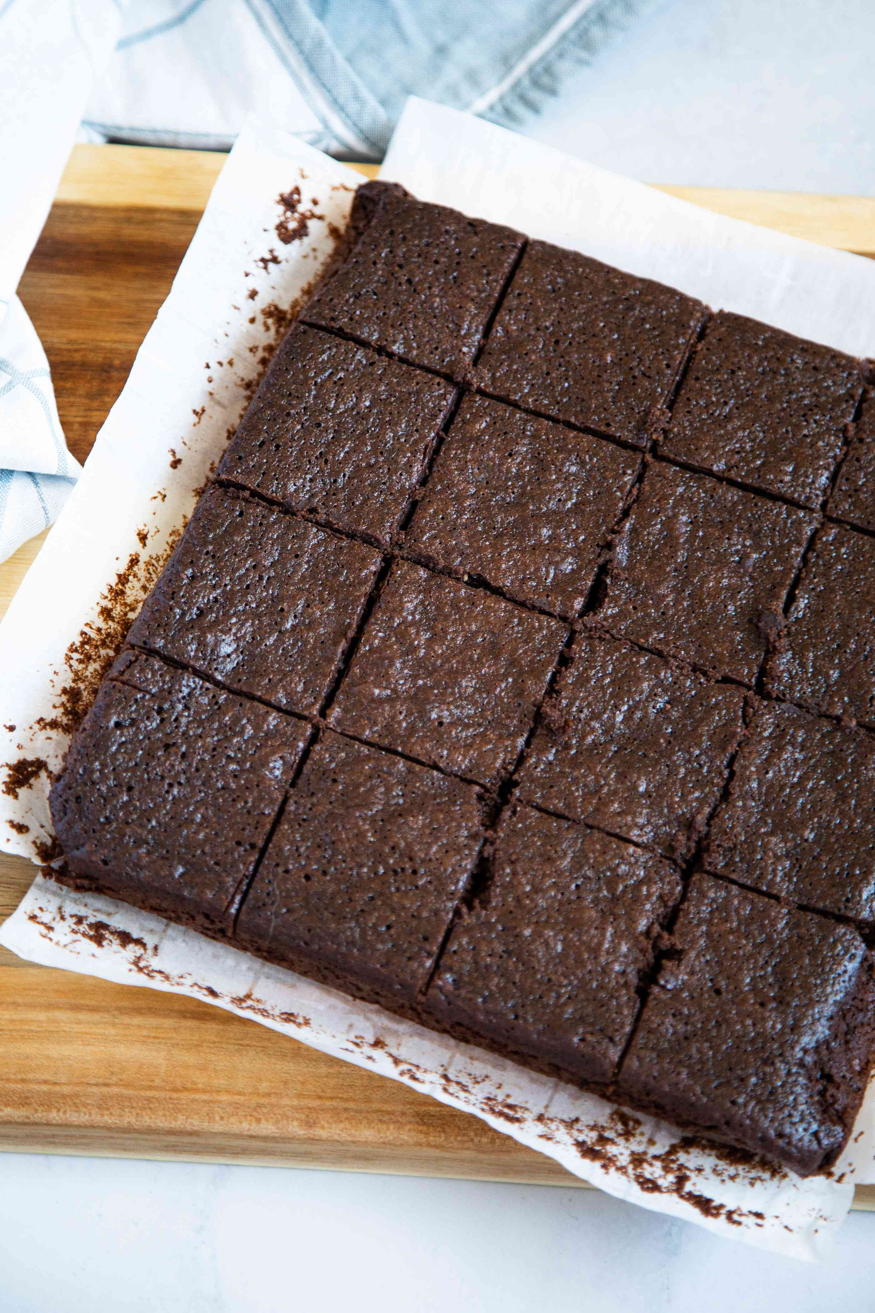 Flourless Soy Sauce Brownies by Hetty McKinnon cut into squares and in a pan.