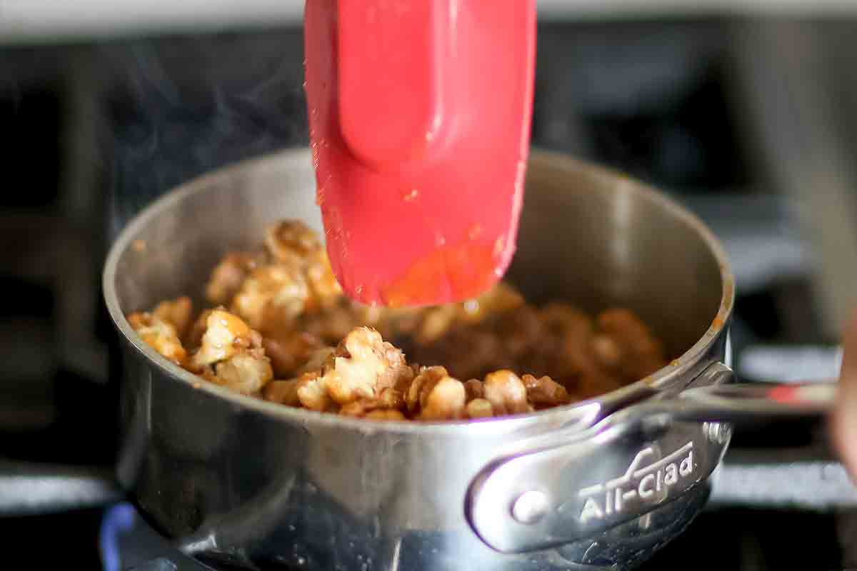 how to make candied walnuts - add the walnuts to the caramelized sugar