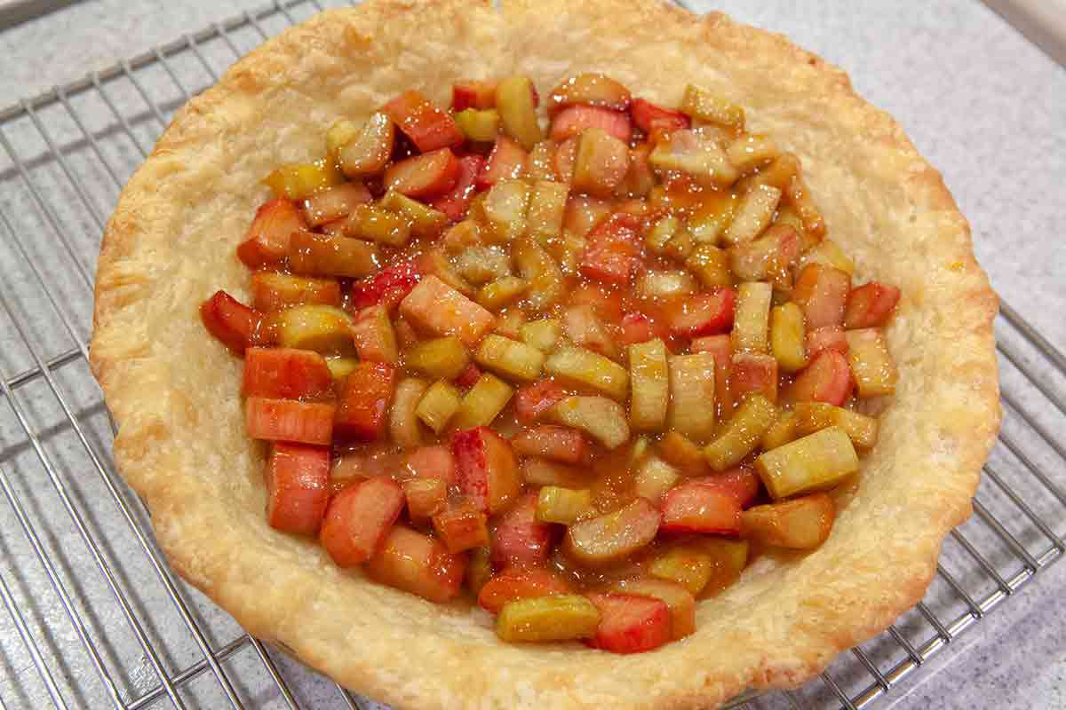 pour rhubarb filling into the pre baked pie shell