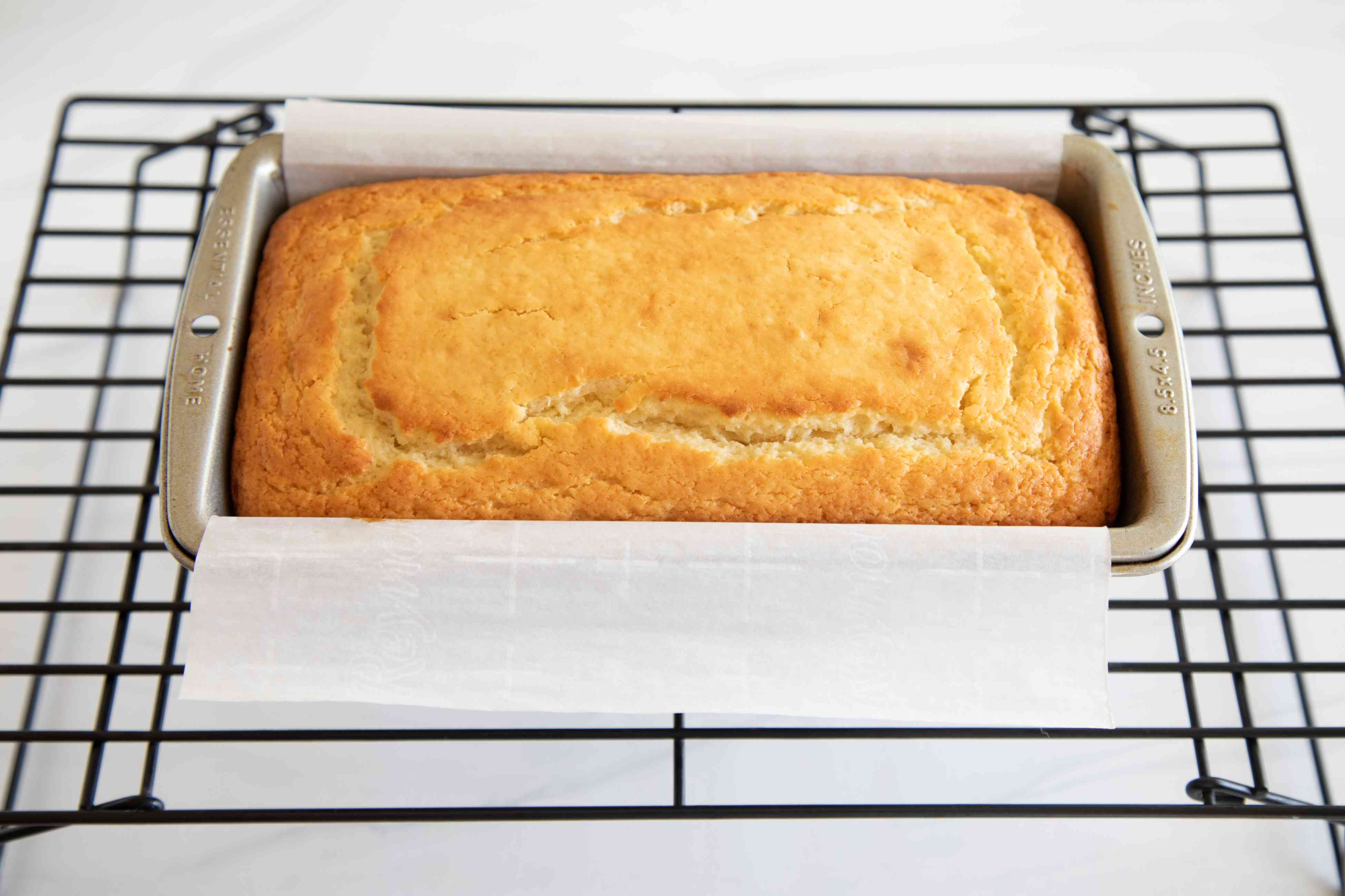 The BEST Yogurt Cake You'll Ever Eat cooling on a rack.