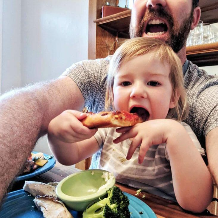 Child eating homemade pepperoni pizza
