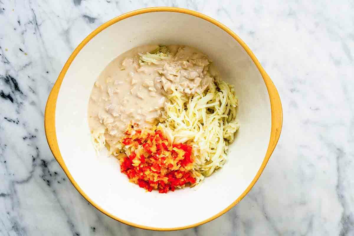 Funeral Potatoes Ingredients - cream of chicken soup, potatoes, red peppers