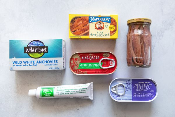 Collection of anchovies cans, jars, tubes