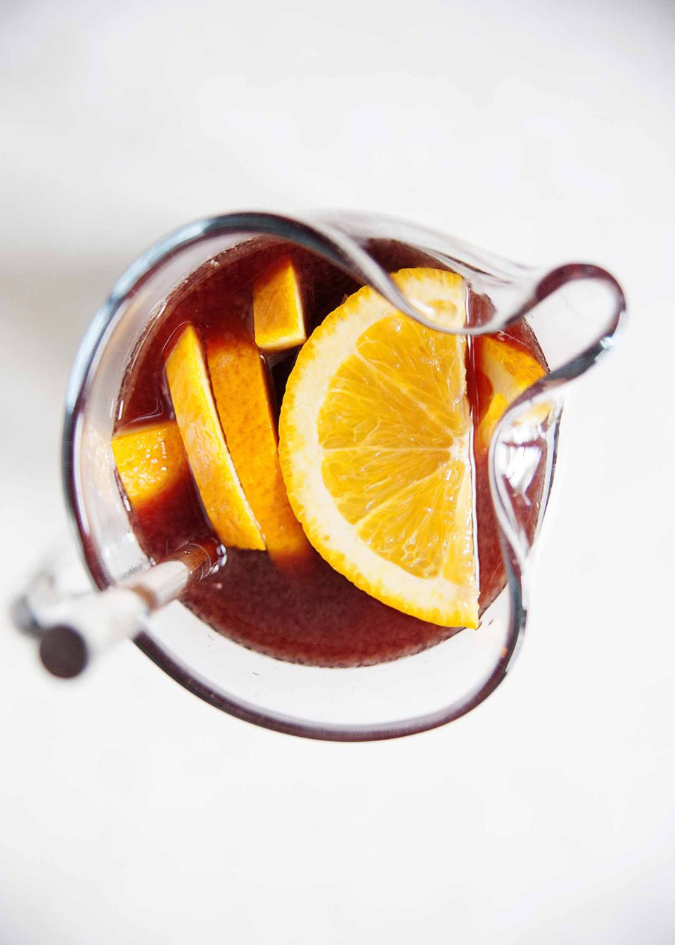 Best Red Wine Sangria - photograph of orange slices in a pitcher of sangria
