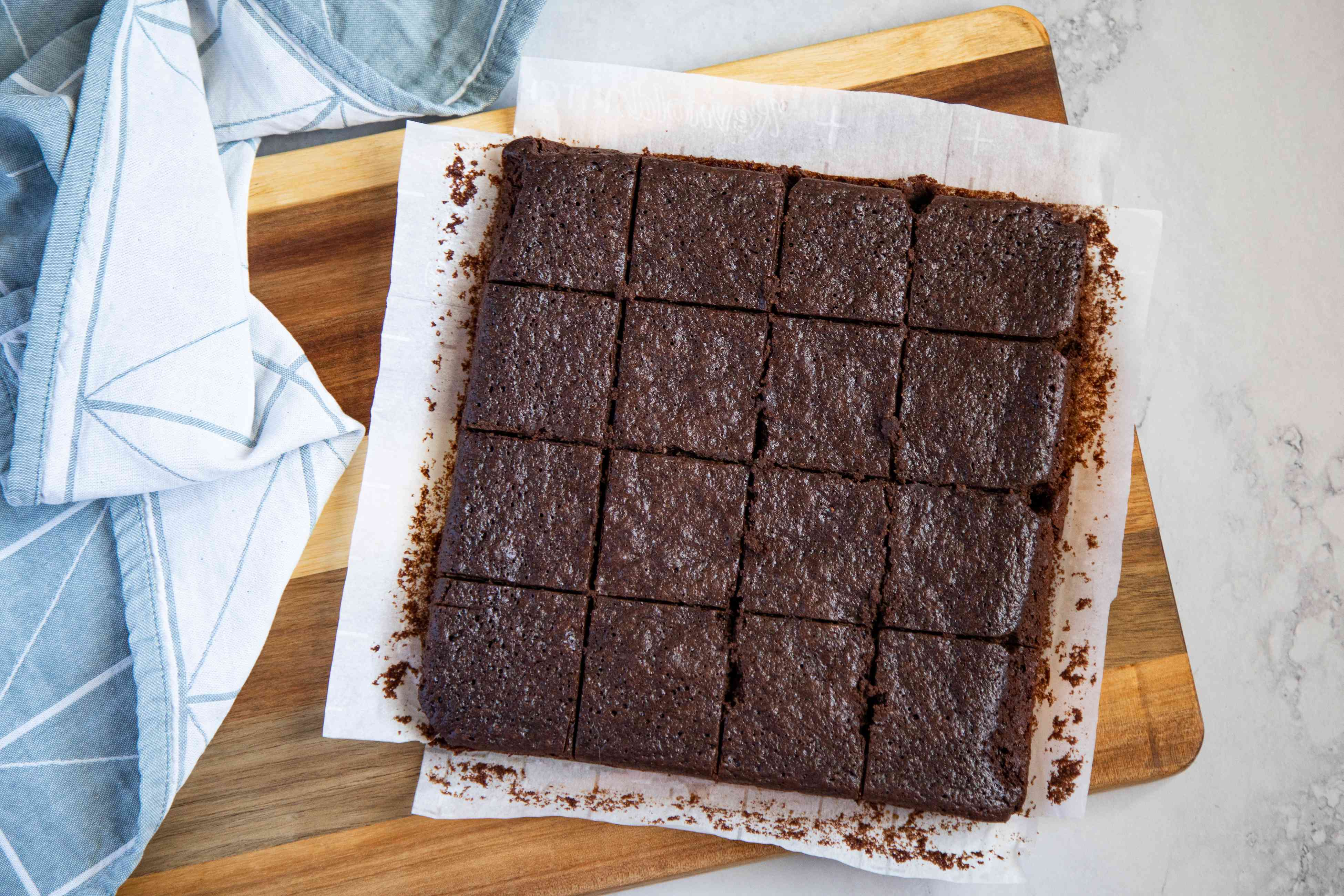 Gluten-Free Soy Sauce Brownies cut into squares on a cutting board.