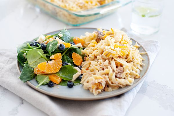 The best tuna casserole on a plate with a salad.