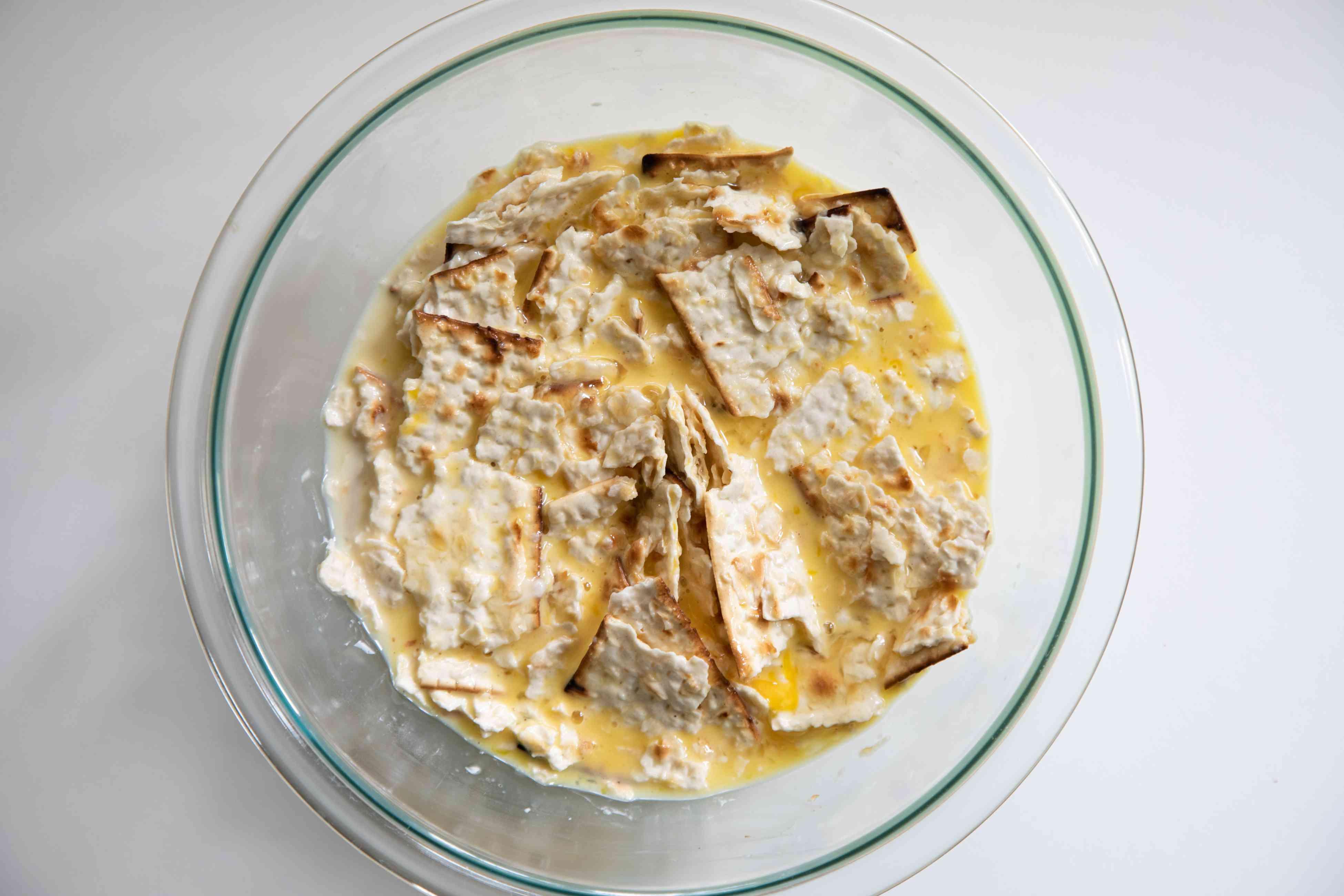 matzah brei soaking in a bowl