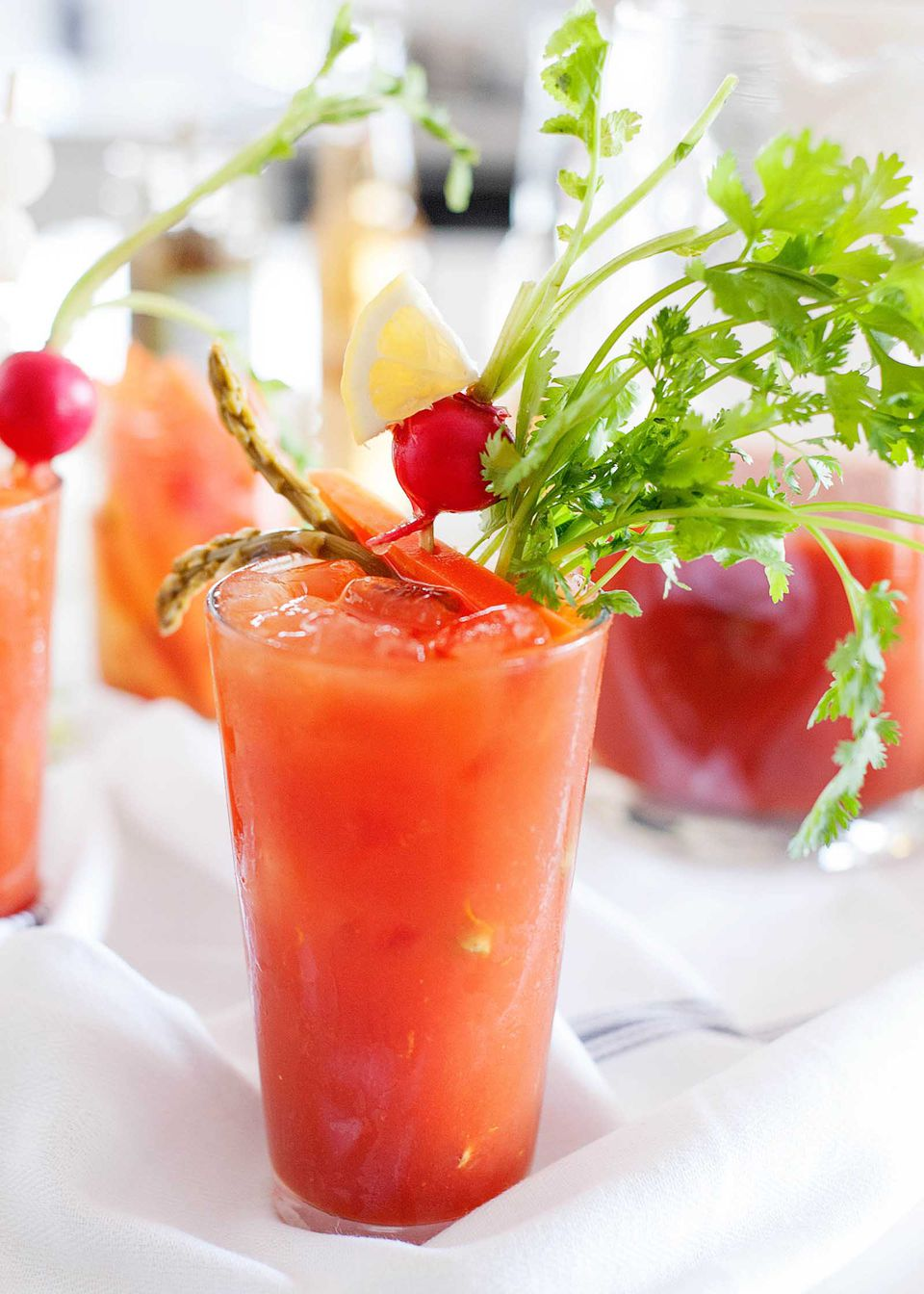 What Is a Bloody Maria? - orange red breakfast cocktail with veggies garnish