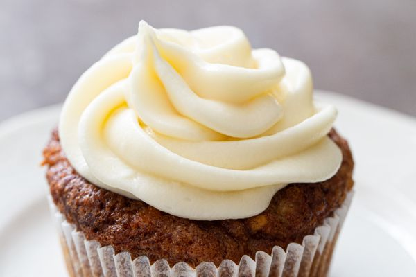 Cream Cheese Frosting swirled on top of a cupcake