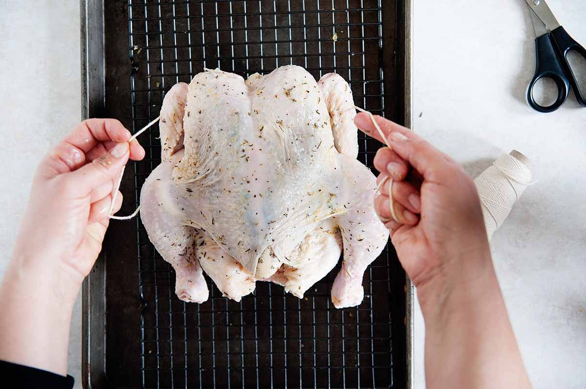 How to Dry Brine a Chicken - trussing a whole chicken