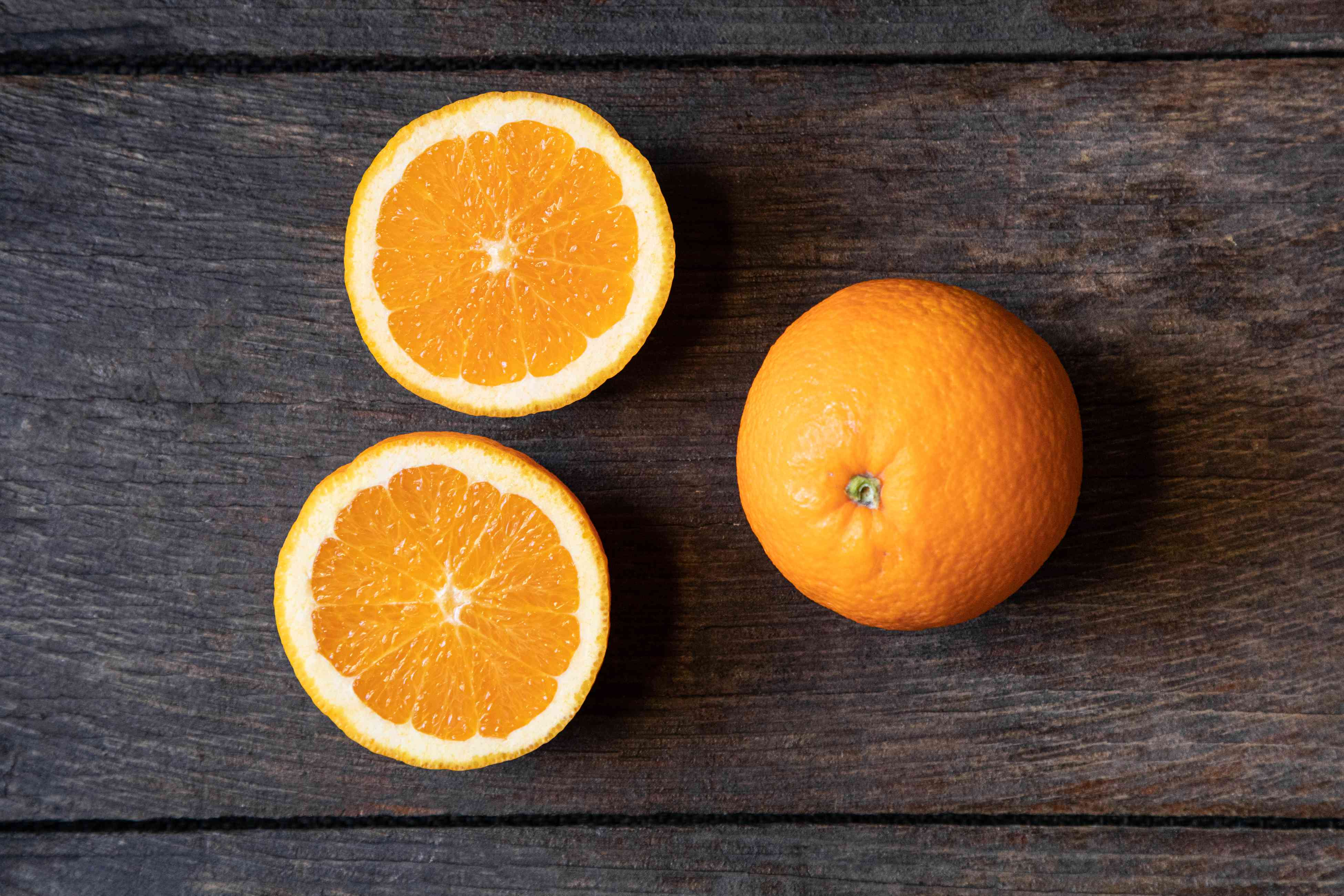 Valencia oranges on dark background
