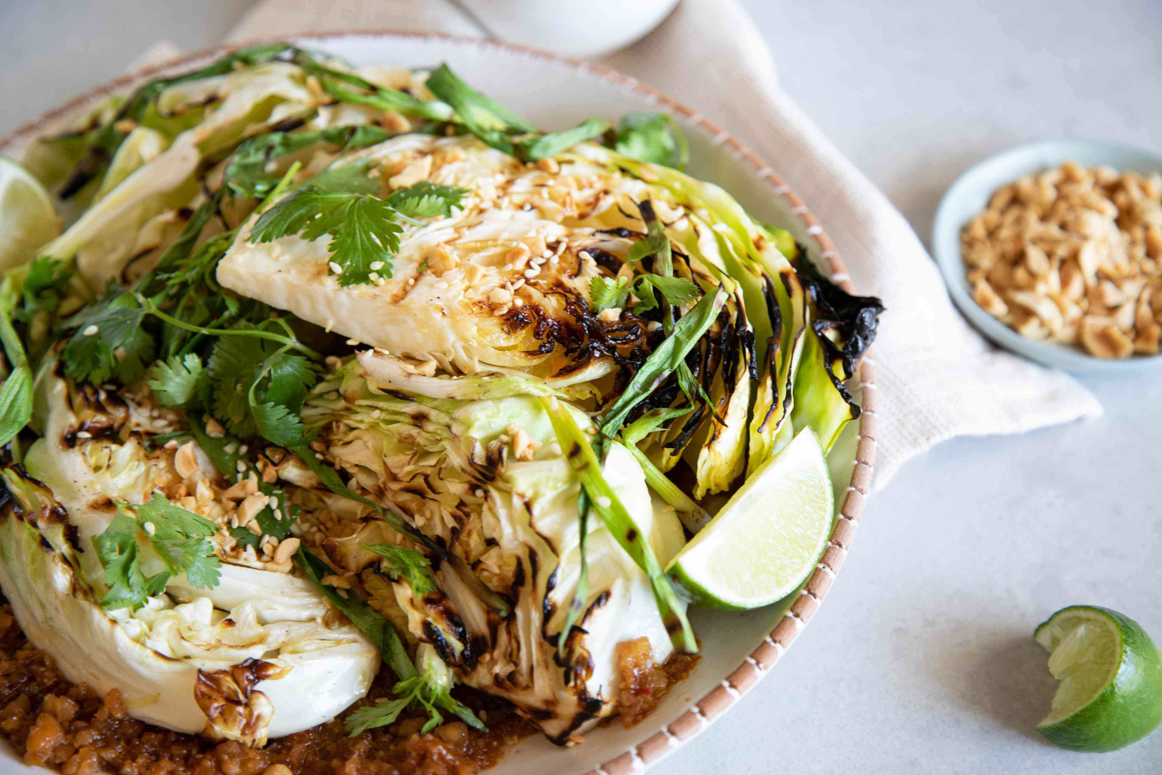 Side view of Grilled cabbage wedges with peanut sauce.