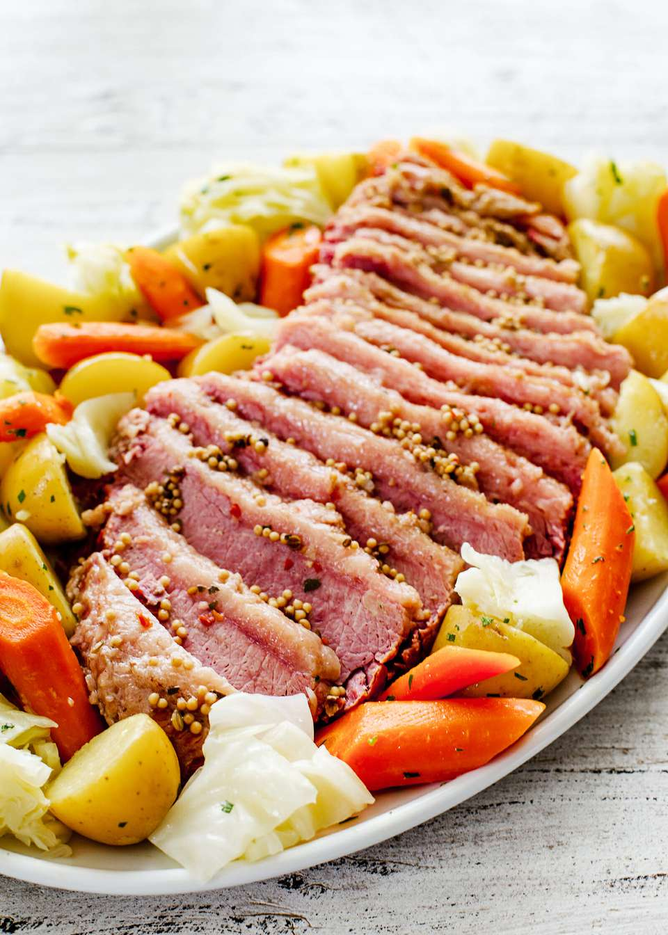 Corned Beef and Cabbage Recipe - corned beef, cabbage, potato, carrots on platter