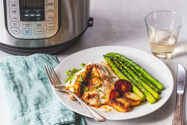 Pressure Cooker Ginger-Soy Tilapia with an Instant Pot set behind it.