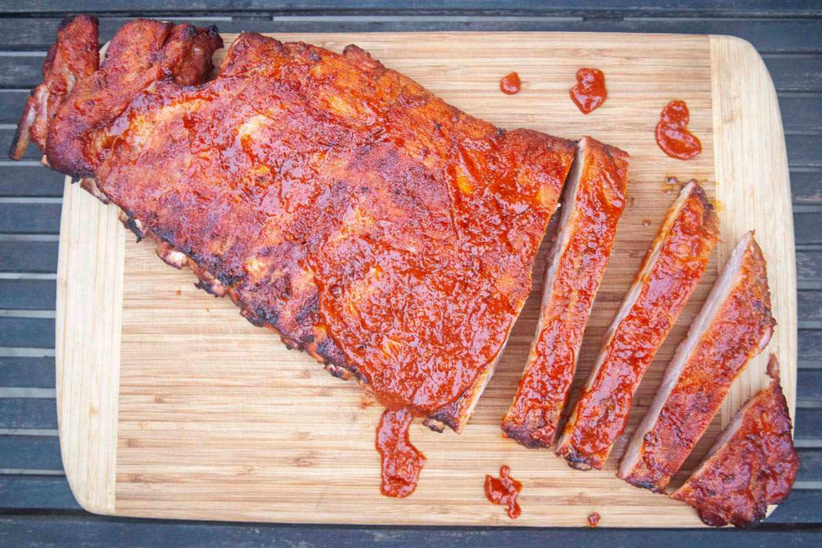 A rack of sauced ribs sliced on a cutting board for a Korean Baby Back Rib Recipe.