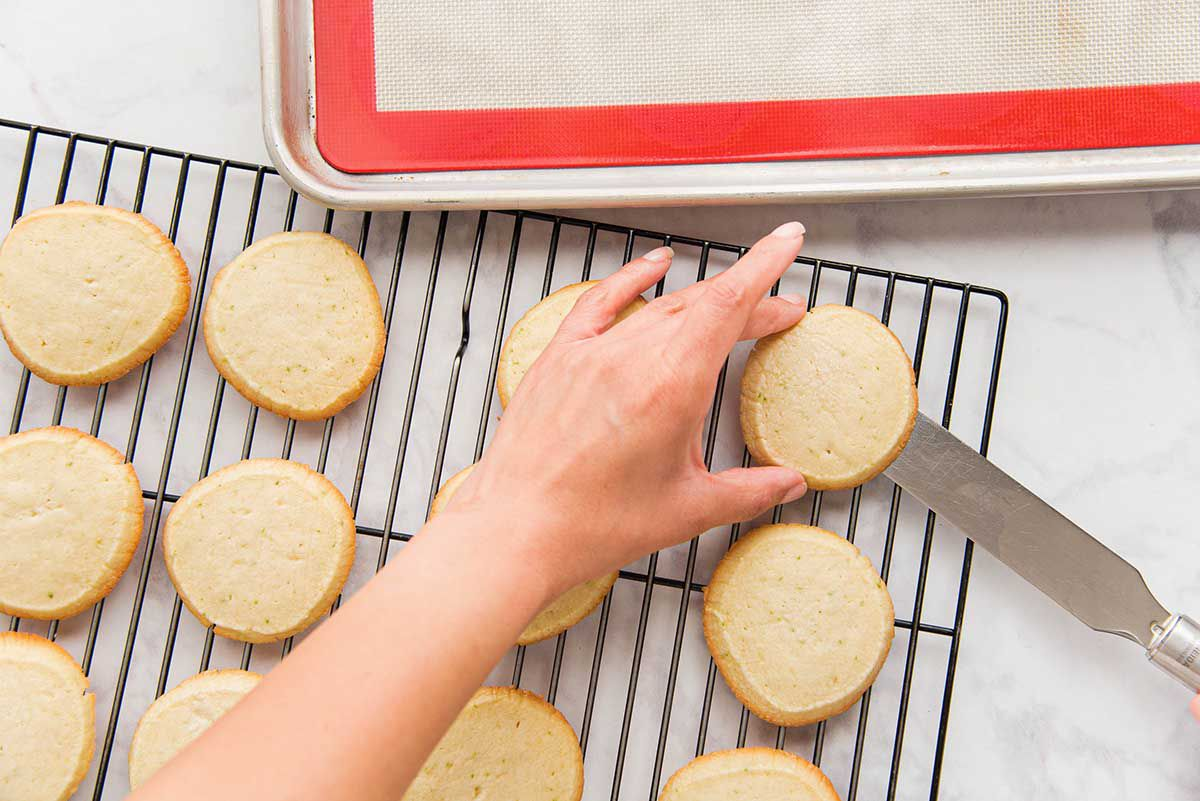 Baked lime cookies cooled on a cooling rack.