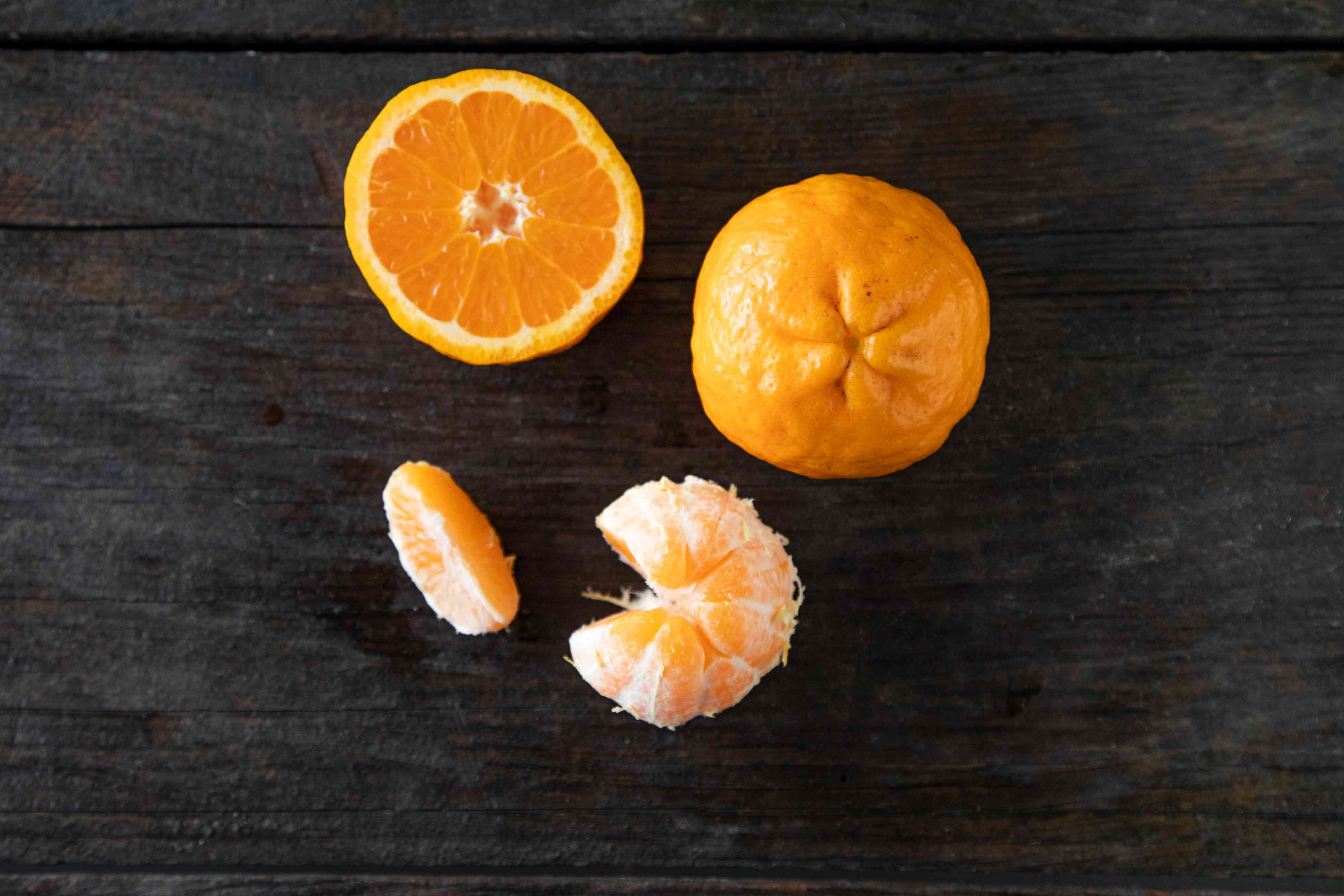 Satsuma mandarin on dark background