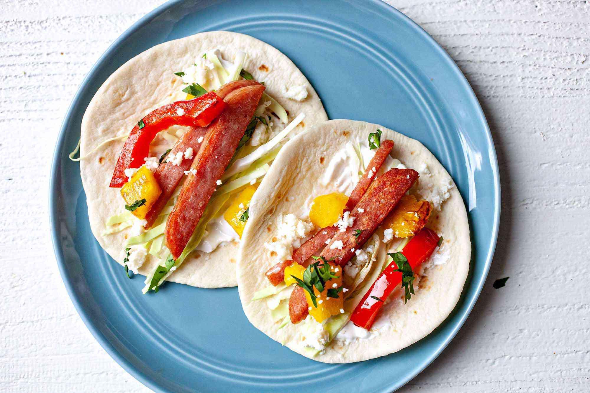 Pork pineapple tacos serve the tacos