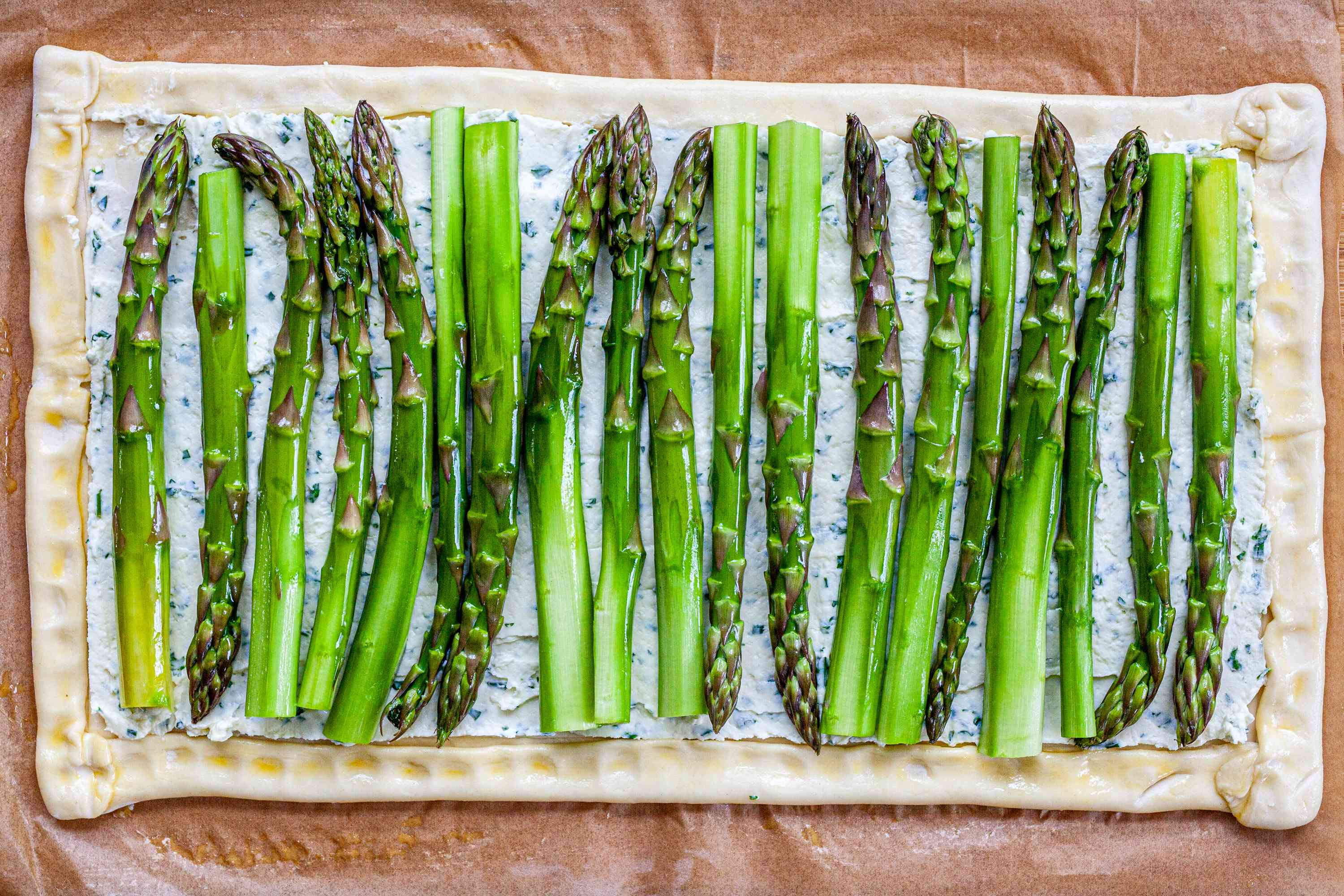 Stalks of asparagus added to an Asparagus Tart with Goat Cheese and Lemon.