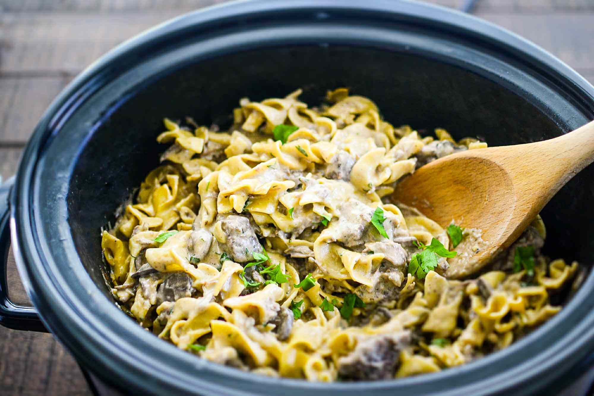 Stir the noodles into the finished crockpot beef stroganoff