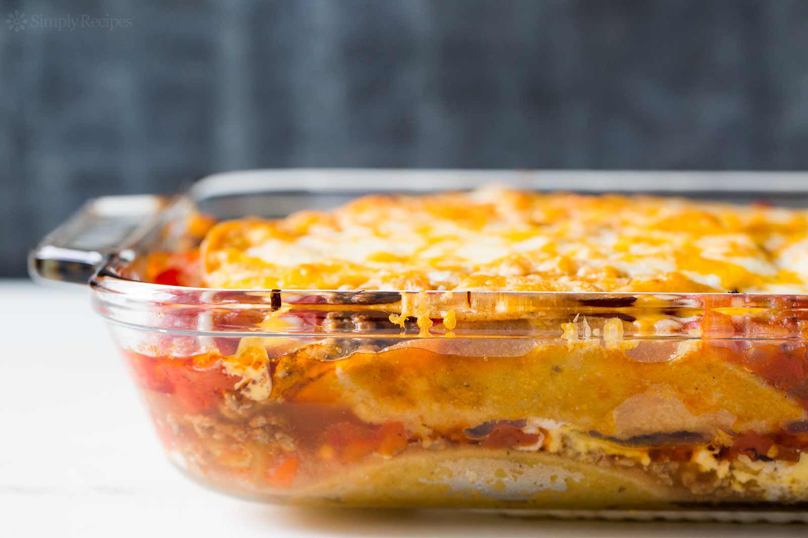 Mexican Lasagna made with tortillas, beef, beans, and cheese ready to serve