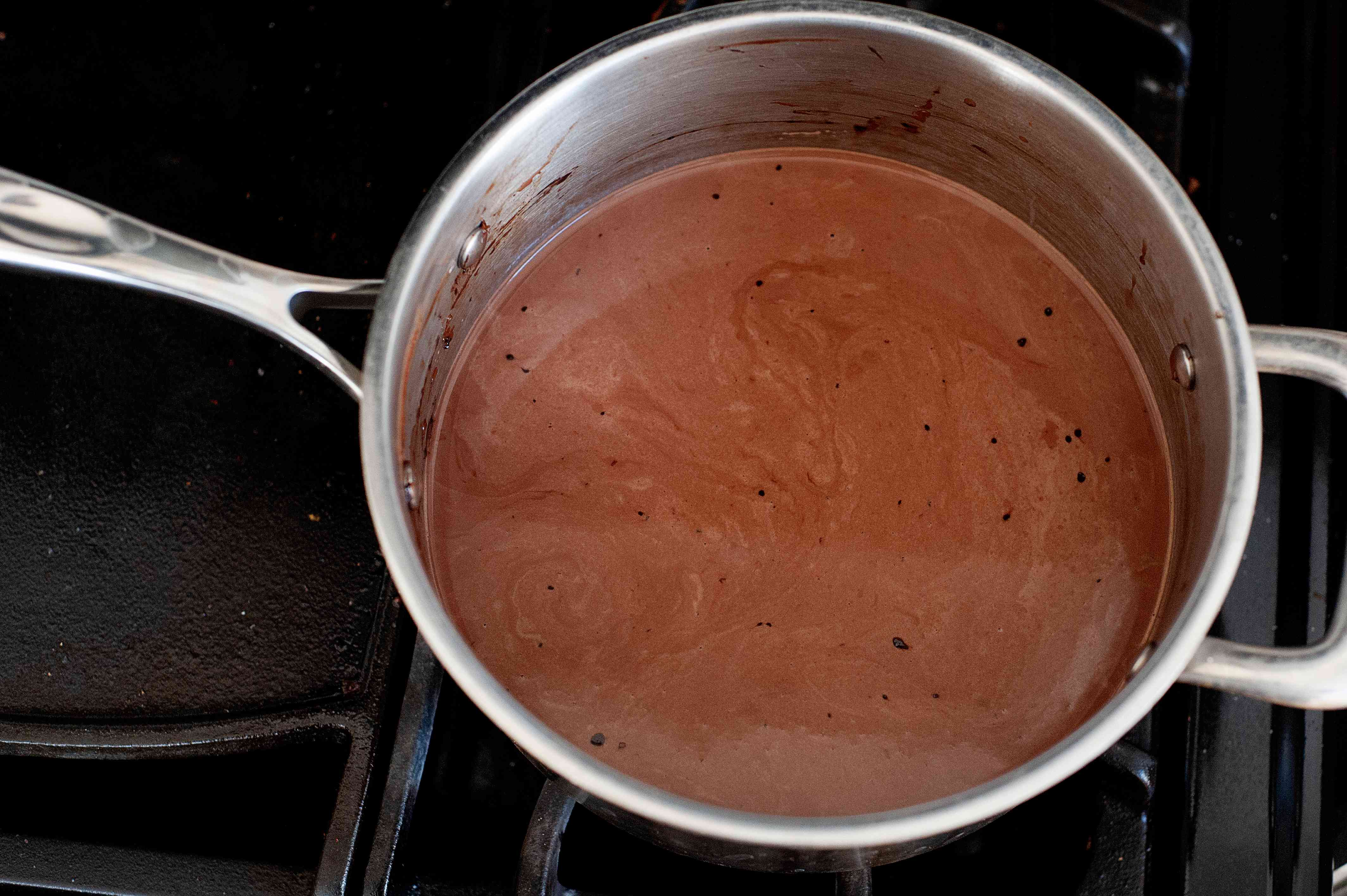Melted chocolate in a saucepan to make a chocolate ice cream recipe.