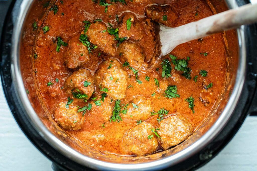 Cheesy slow cooker sausage meatballs cooked in a crockpot