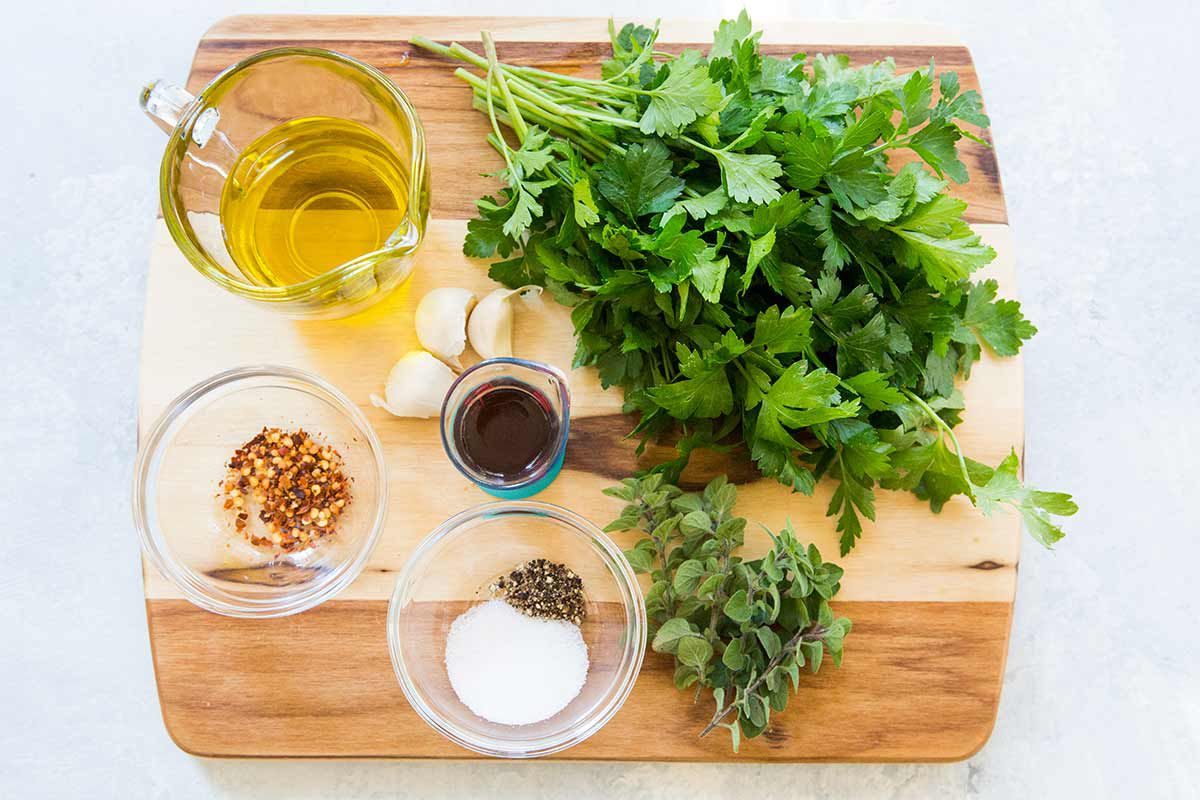 Ingredients for Chimichurri Sauce on wood cutting board