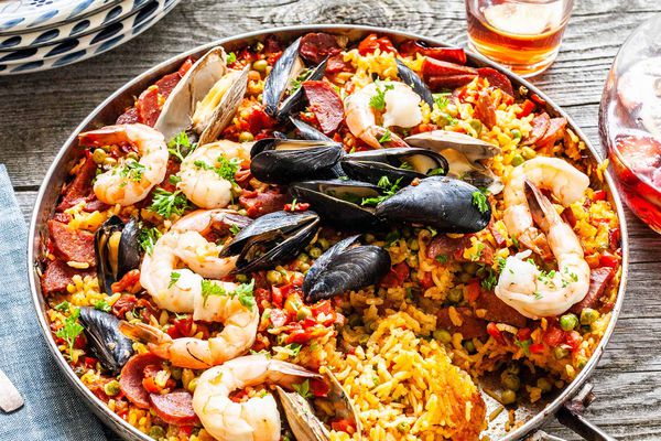 Finished seafood paella from the grill in a skillet ready to serve