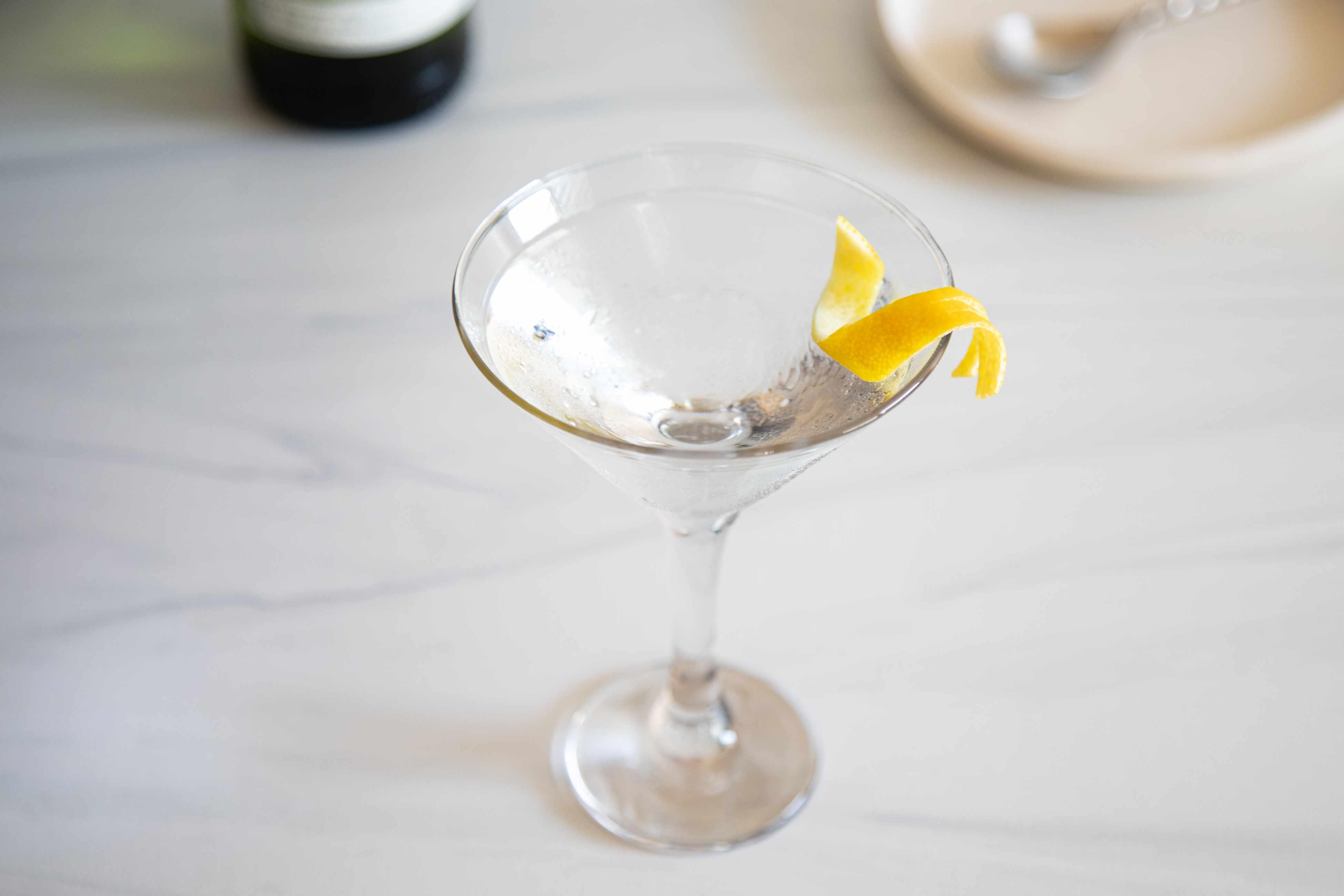 50/50 Gin Martini with a lemon peel garnish.