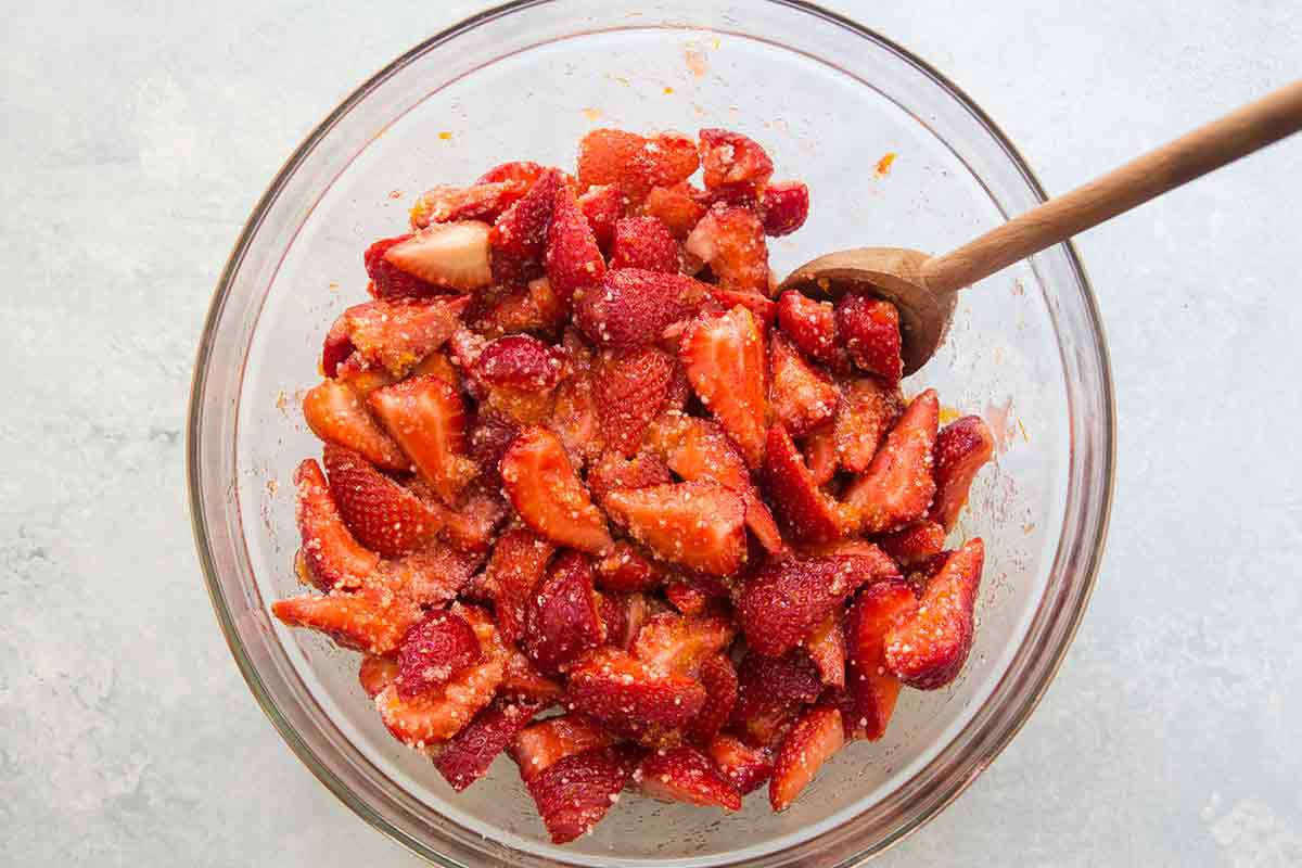coat strawberries with sugar for american flag pie filling