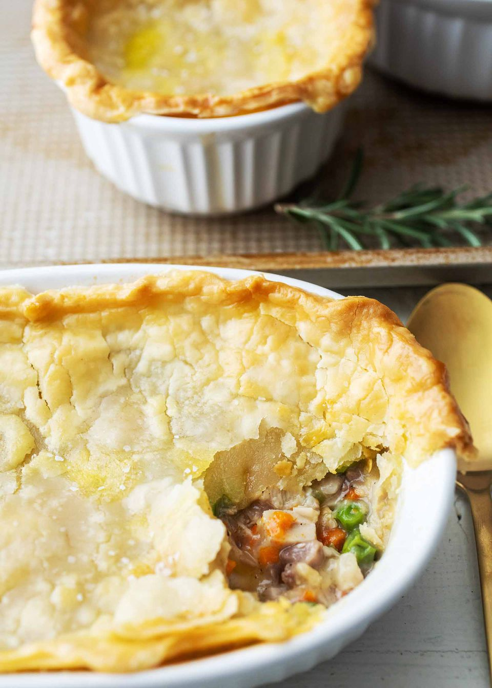 Two casserole dishes of leftover turkey pot pie