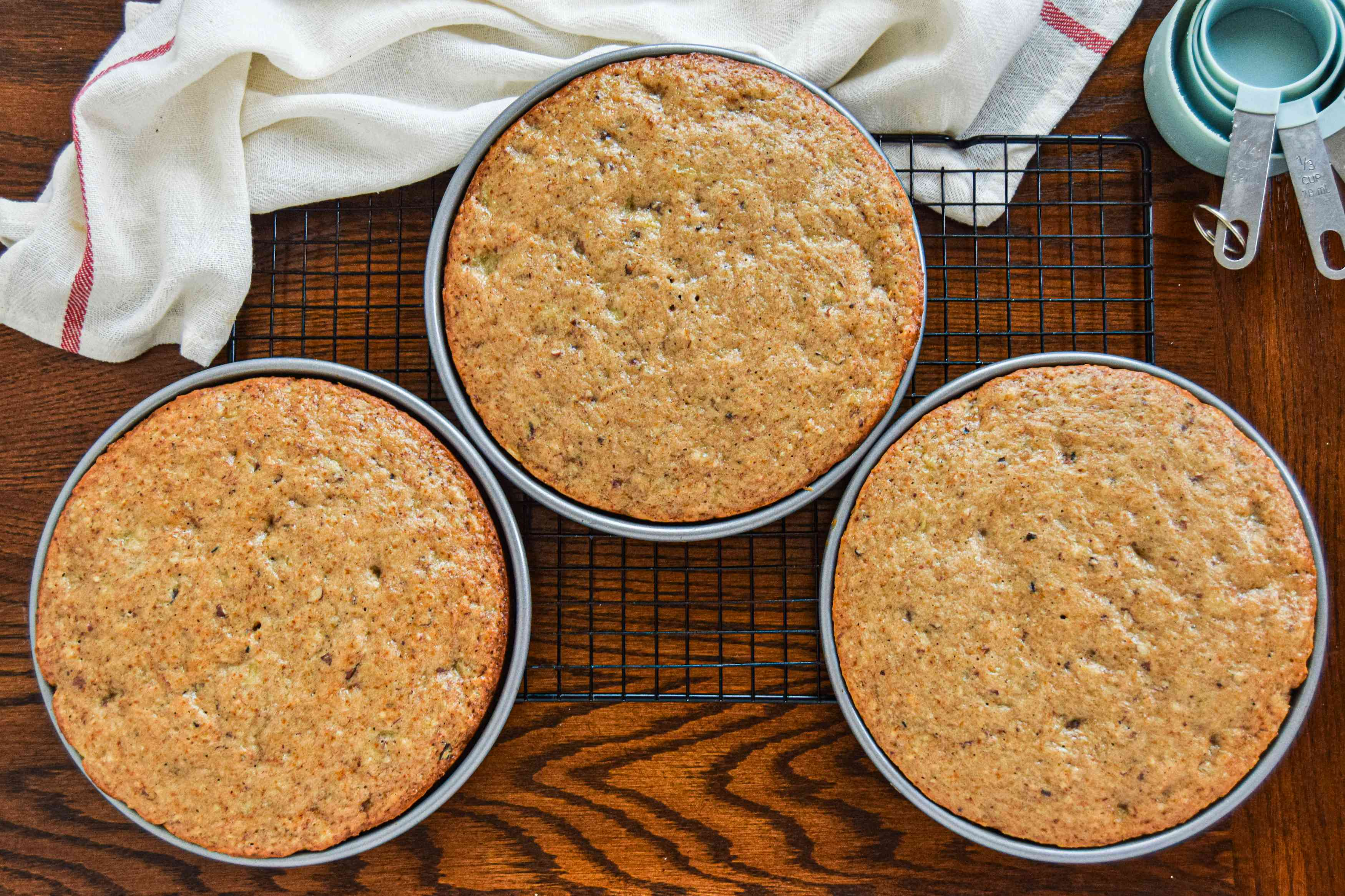 Overhead view of three southern hummingbird cake layers set on a cooling rack.