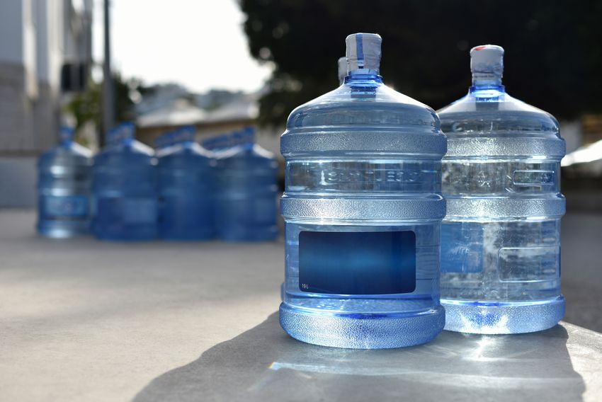 jugs of water outside a house