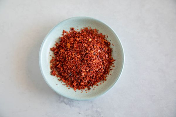 Aleppo pepper flakes in a light blue bowl