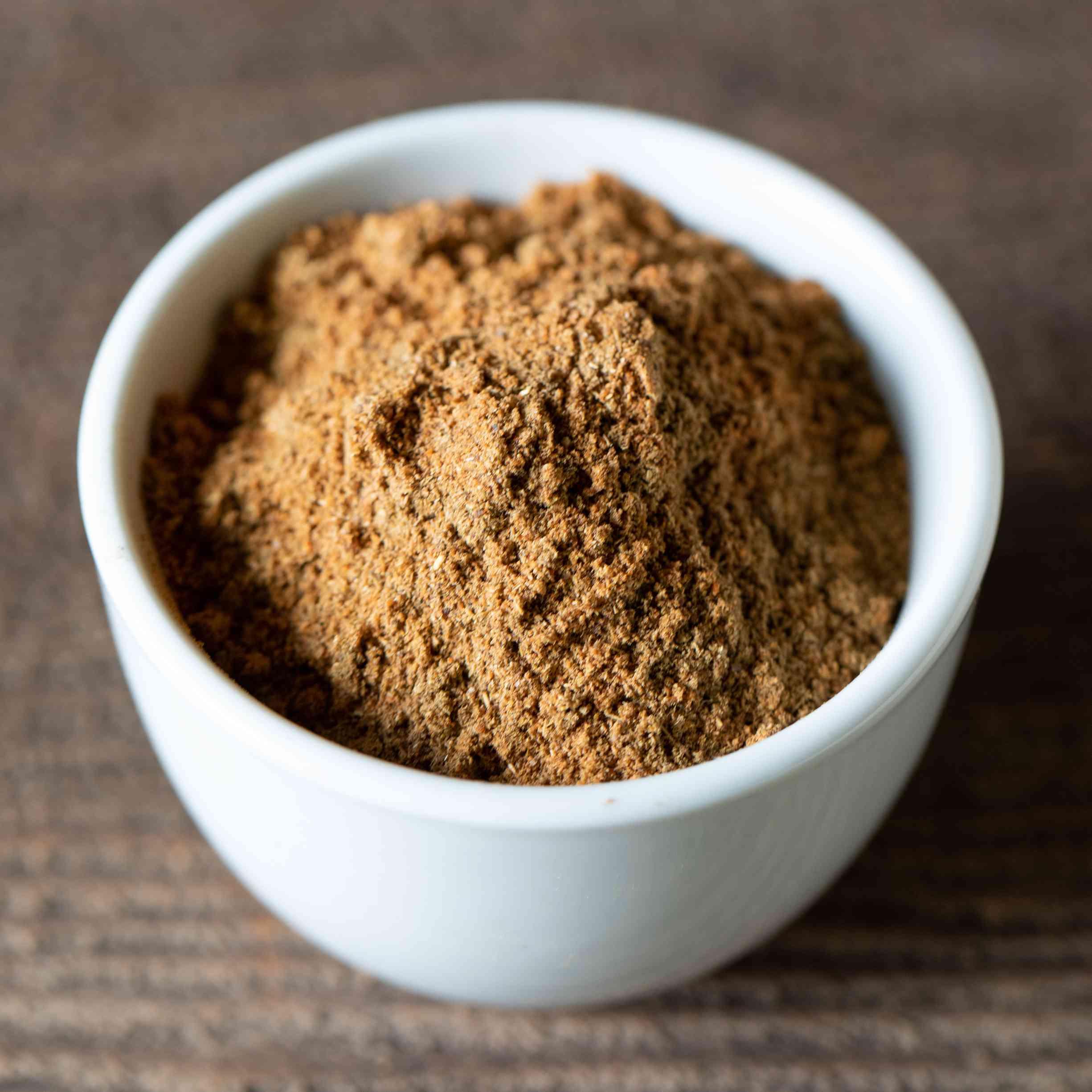 ground garam masala Indian spice mix in a white bowl