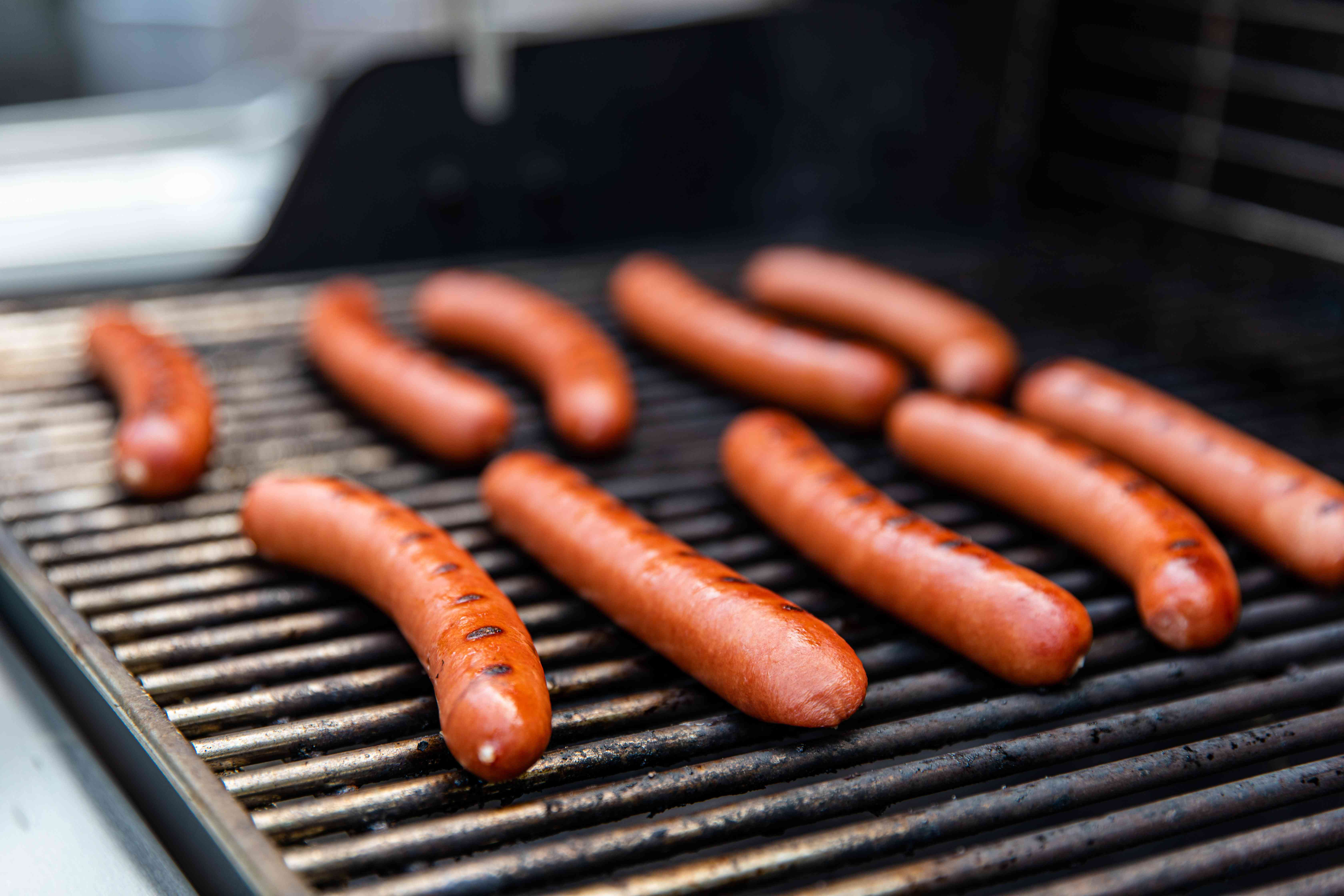 Chicago-style hot dogs on the grill.