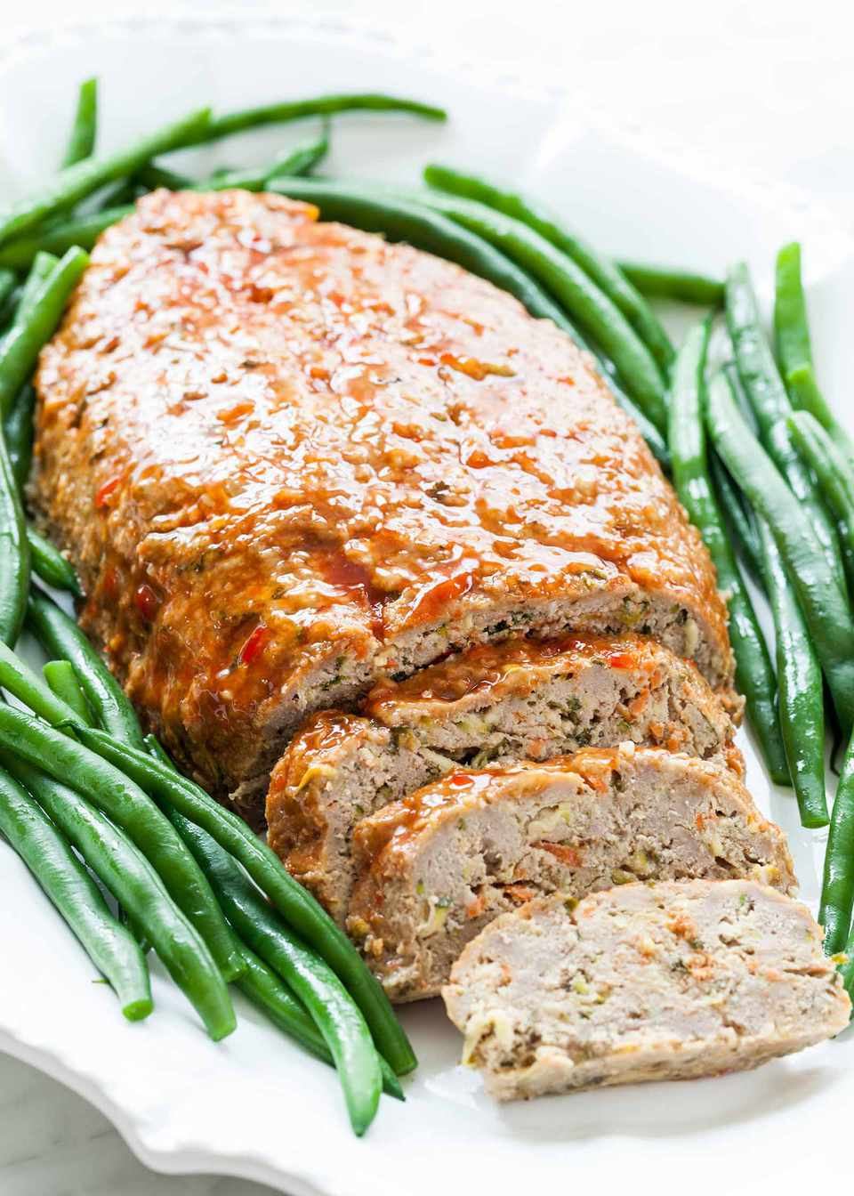 Ground Turkey Meatloaf Cut into slices and served with green beans