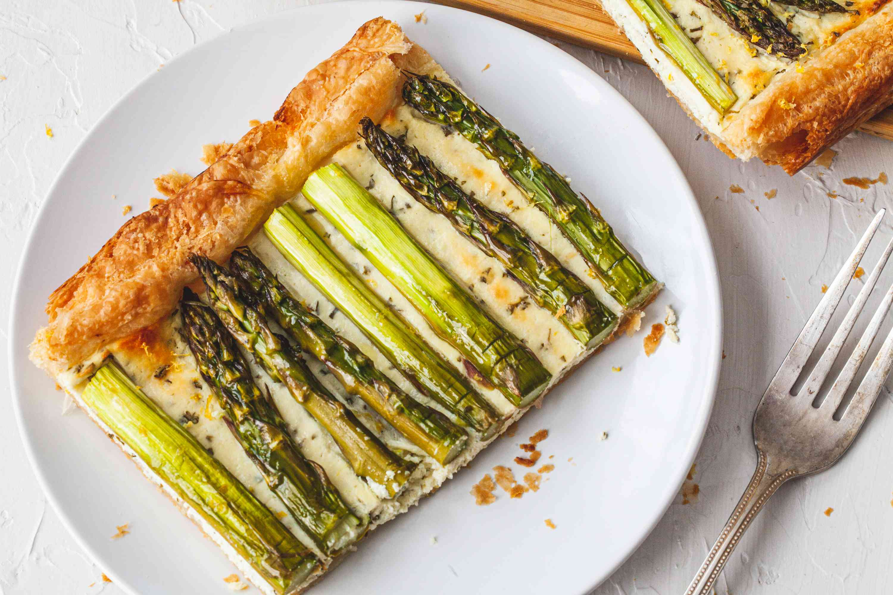 A plate with a slice of Easy Asparagus Tart.