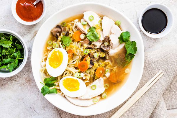 Easy Chicken Ramen Recipe with Noodles and poached eggs in a round bowl