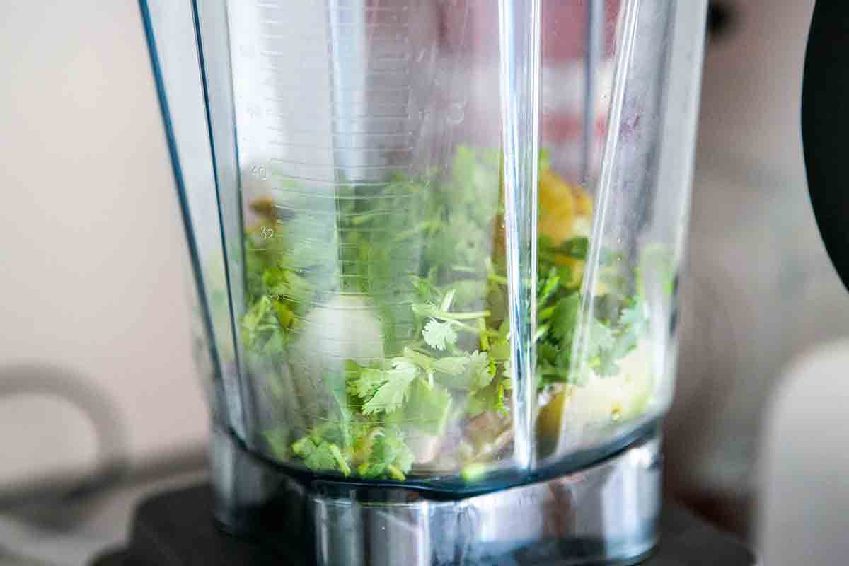 roasted tomatillos and cilantro in blender