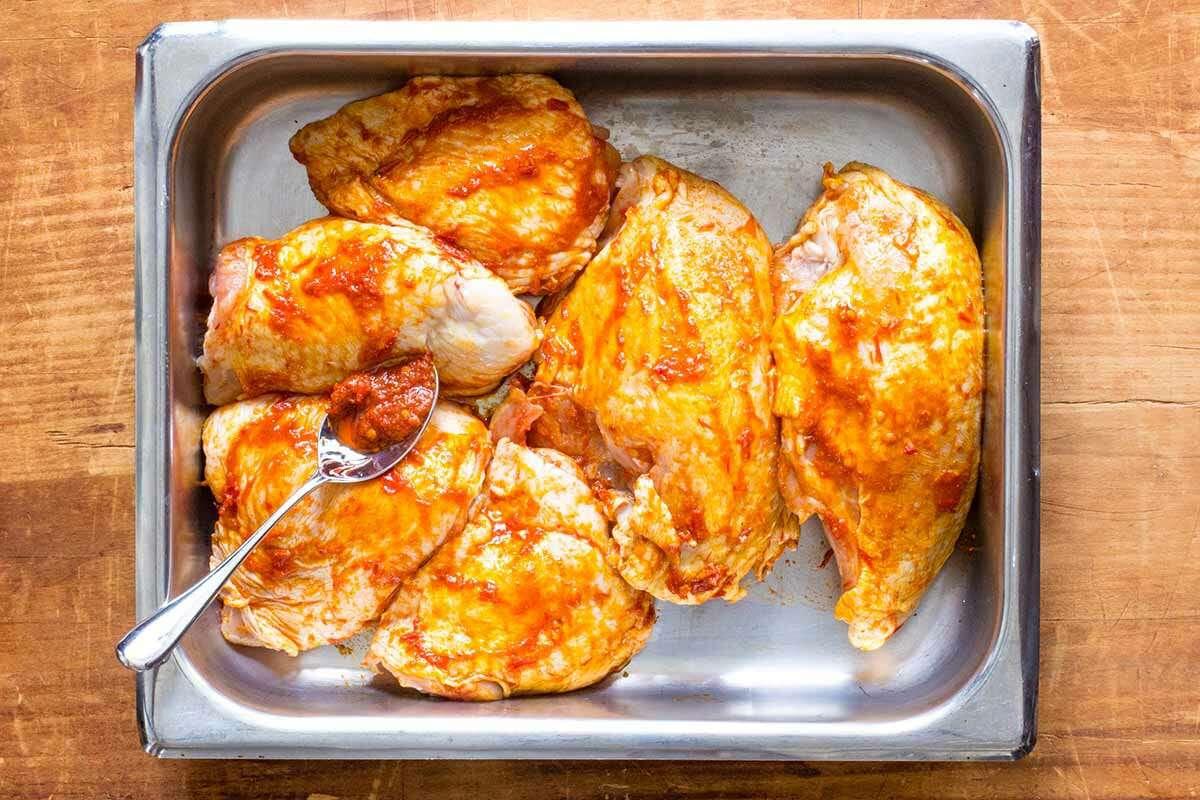 Sheet Pan Chicken with Cauliflower marinate the chicken