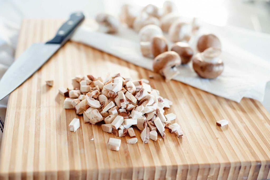 chopped mushrooms on cutting board