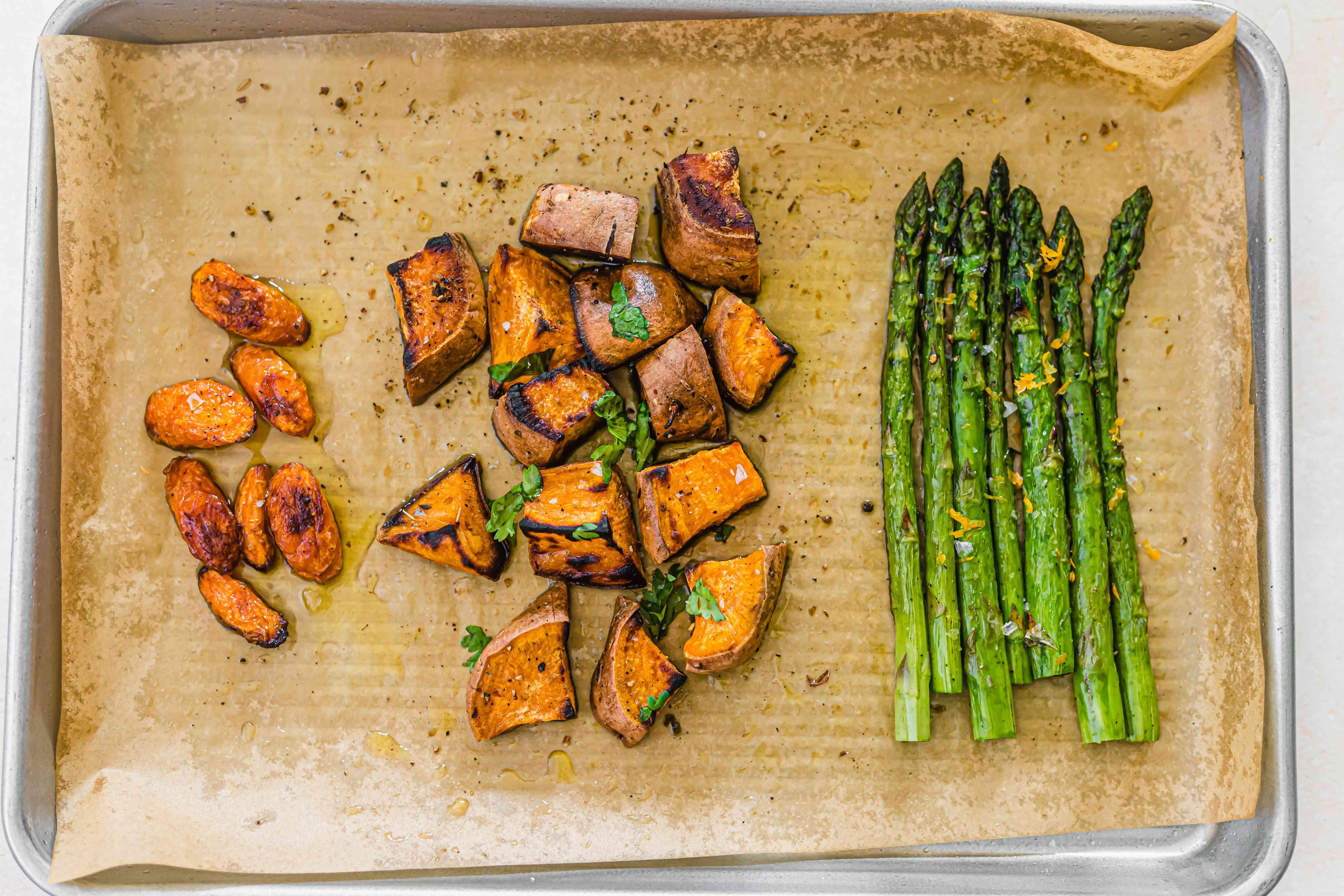 Roasted carrots sweet potatoes asparagus on a sheet pan