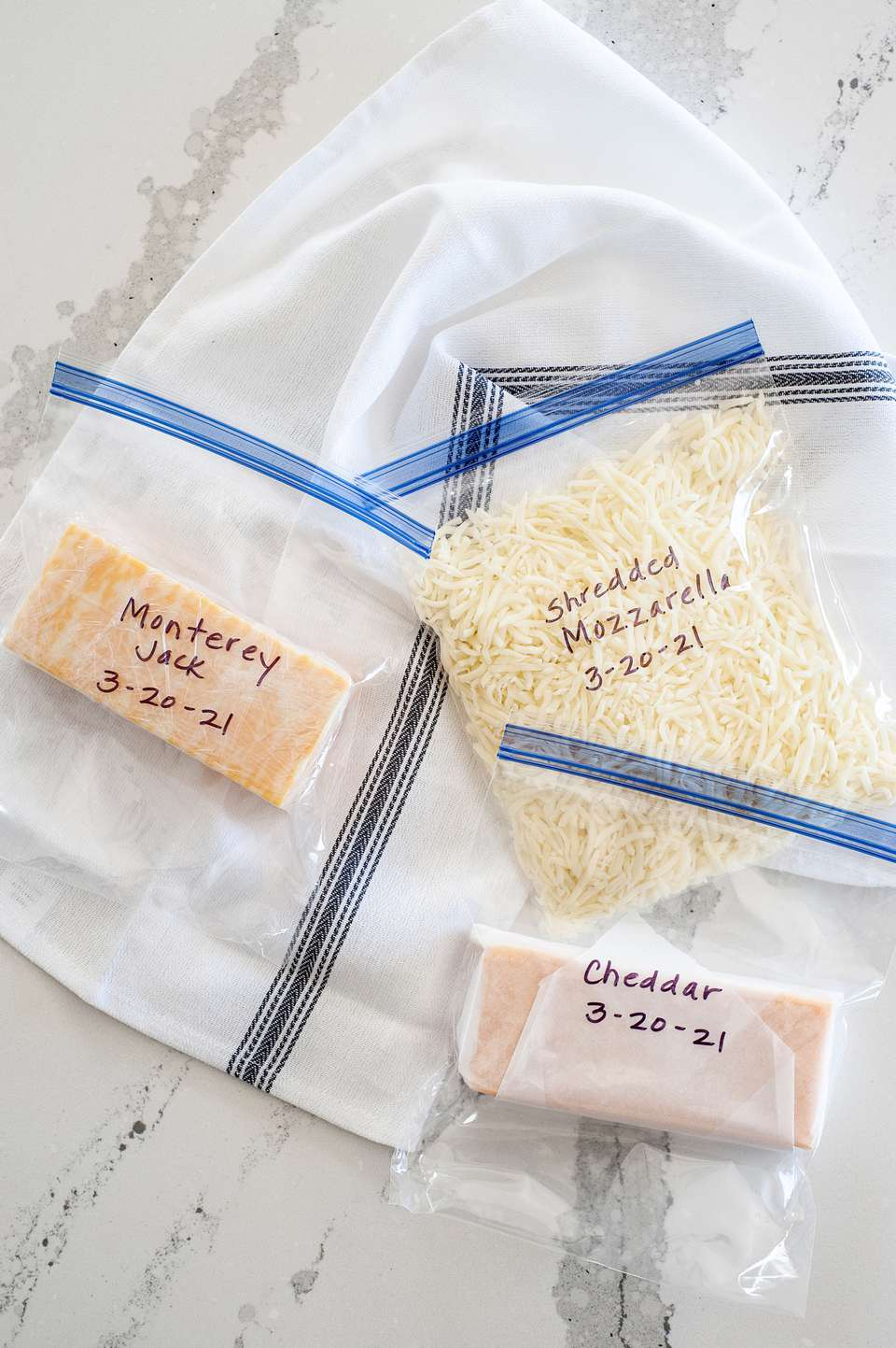 Cheese in ziplock bags to show how to freeze cheese.