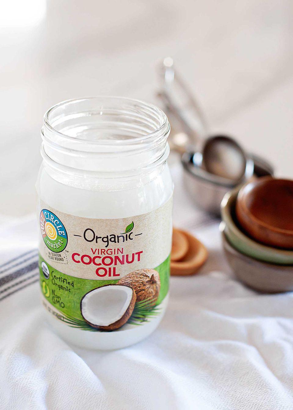 Jar of solid virgin coconut oil
