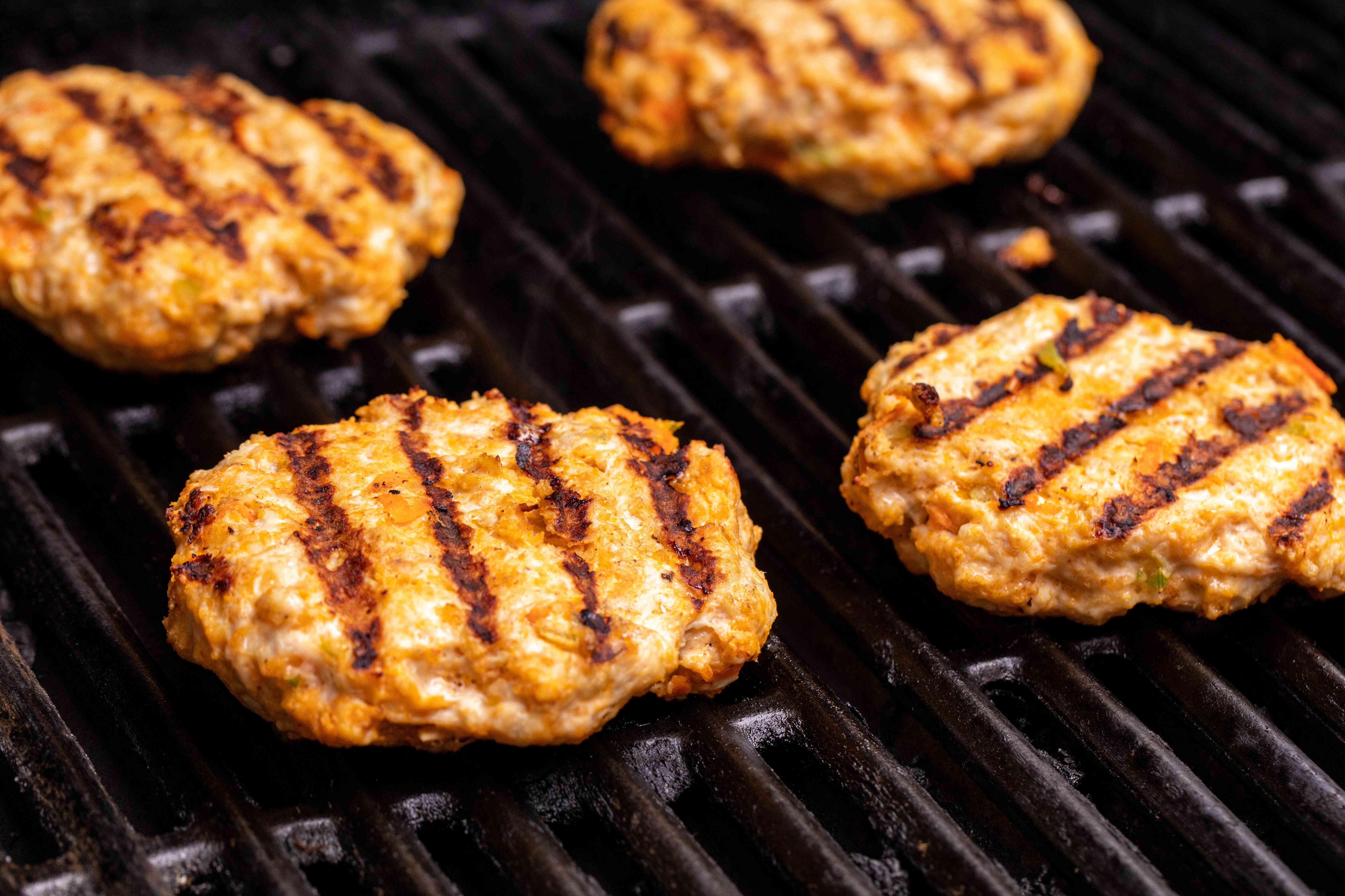 Grilling Buffalo chicken burgers.