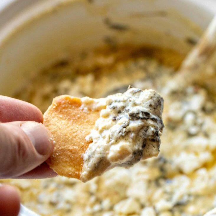 mediterranean spinach feta dip on a pita chip